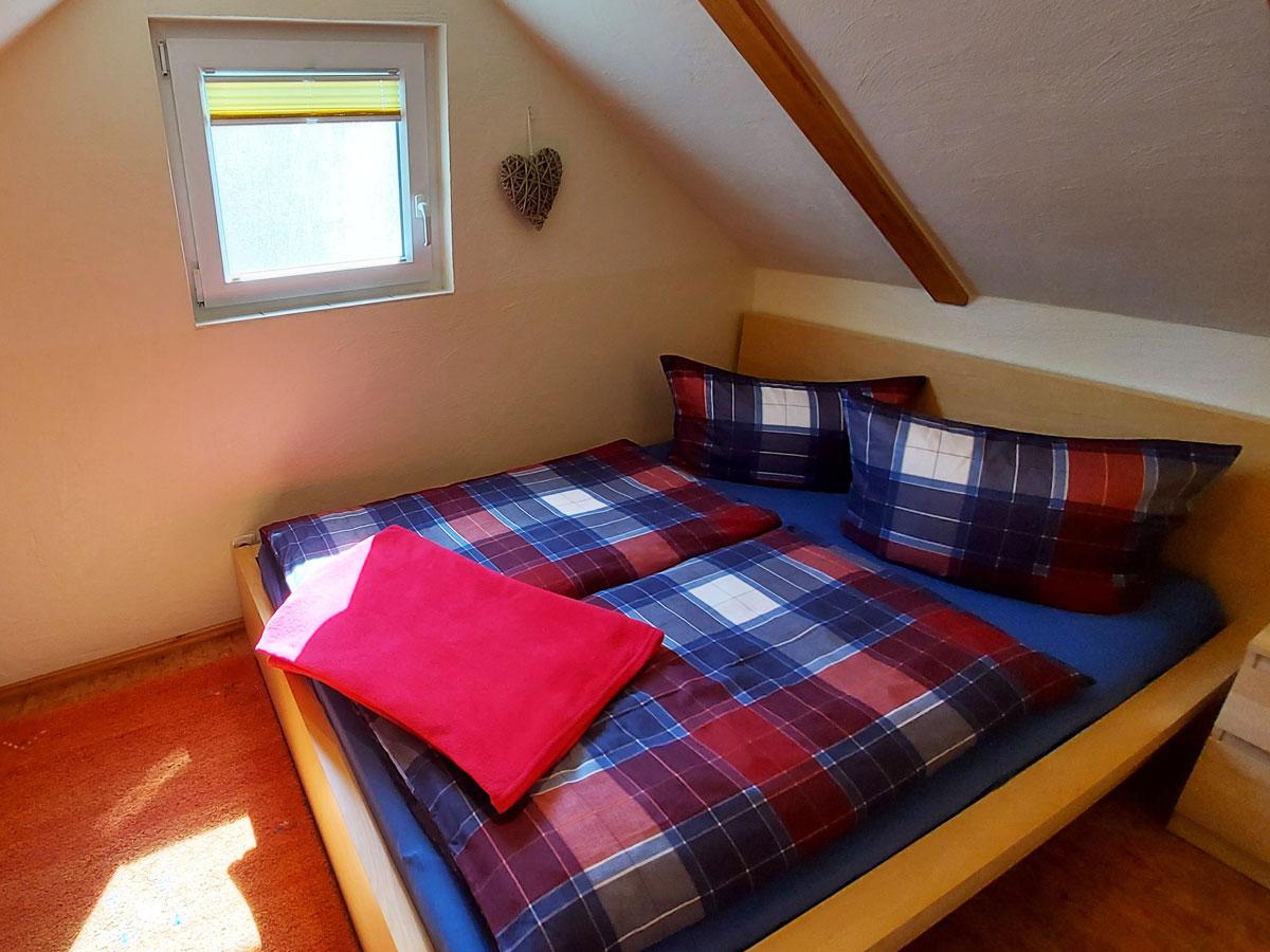 Ferienhaus Dorfbachklamm - Schlafzimmer1 mit Doppelbett