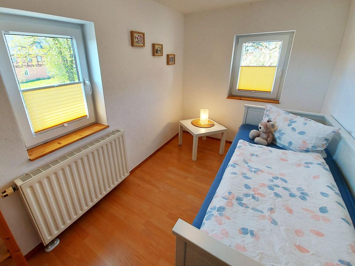 Ferienhaus Schrammsteinblick - Ferienwohnung2 - Schlafzimmer2 mit Bett