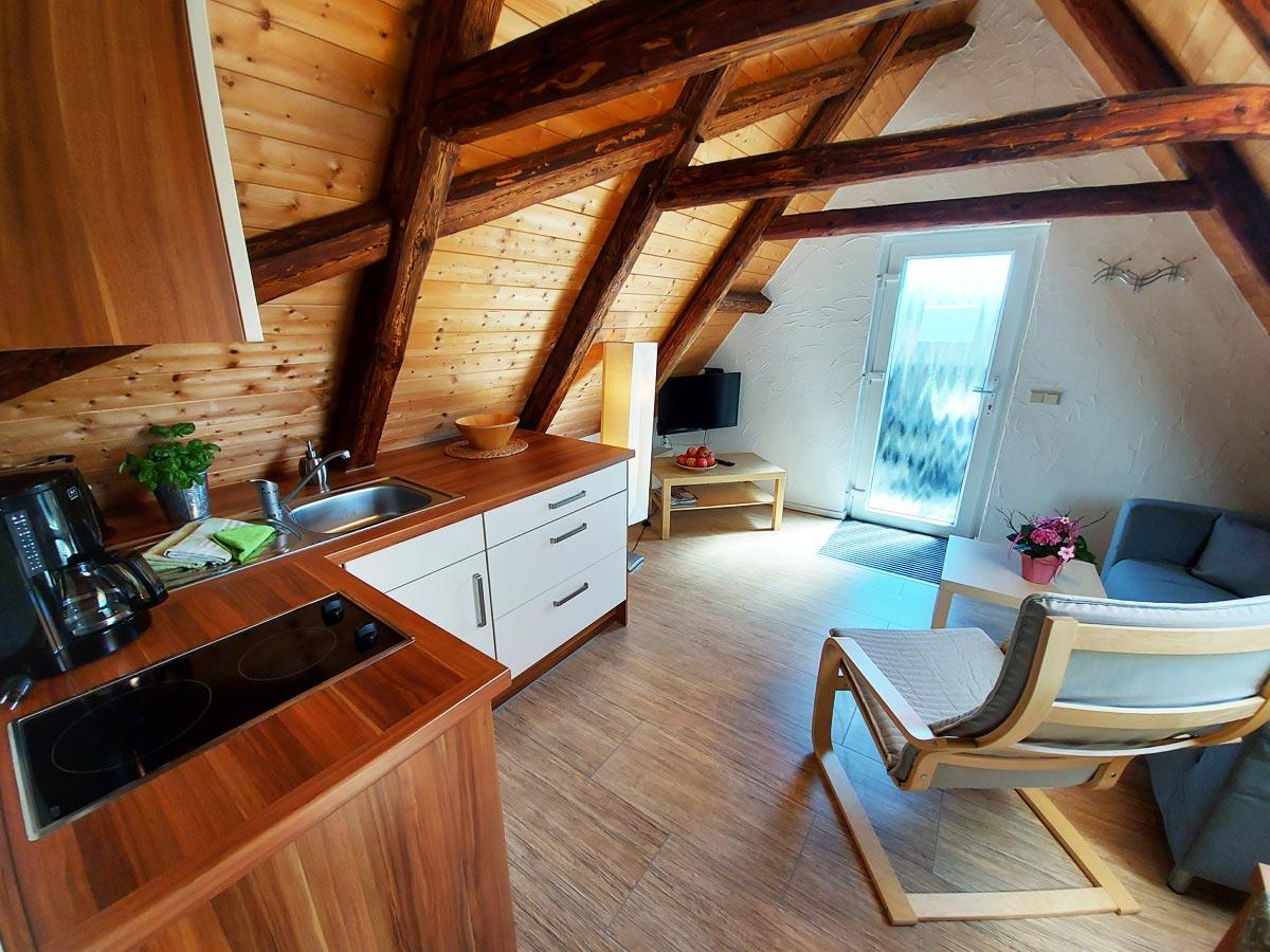 Ferienhaus Schrammsteinblick - Ferienwohnung3 - Wohnküche mit Sofa